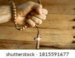 Clenched Fist Holding A Rosary...