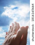 hands praying in the sky   Shutterstock . vector #1816165664