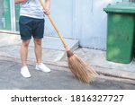 Man using broom sweep the...