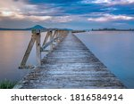 Old Wooden Wharf Shot With Lon...