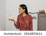 Brunette Asian Woman Blows Out...