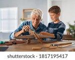 Senior Man Helping Child To...