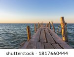 Wooden Pier At The Sunset....