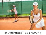 Young Women Playing Doubles At...