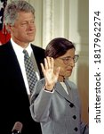 Small photo of Washington, DC.USA, August 10, 1993 Ruth Bader Ginsberg holds her right hand up as Chief Justice William H. Rehnquist administers the oath of office and she is sworn in to the Supreme Court