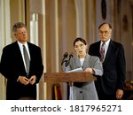 Small photo of Washington DC. USA, August 10, 1993 President William Jefferson Clinton listens to newly sworn Associate Justice Ruth Bader Ginsberg as she addresses members of the White House press in the East Room