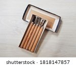 Small photo of Old woodcut tools in box on wooden floor background.