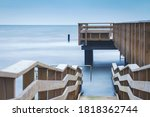Wheelchair ramp attached to a wooden jetty, captured with long shutterspeed