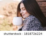 Young Woman Drinking Tea On...