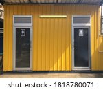 Small photo of Toilet Modular Knock Down with Yellow Metal Sheet Wall ,Selective Focus.