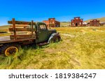 Rusty wreck of a vintage old truck if wood. Bodie state historic park, Californian Ghost Town of the 1800s in the United States of America. Close to Yosemite national park.
