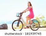 Girl Biking In City Park On...