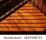 Shadow Of Fence On Wooden Floo...