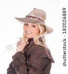 cowgirl in authentic clothing - stock photo