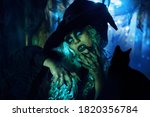 A Scary Ugly Witch Stands In An ...