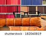 Old Books And Eye Glasses With...