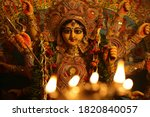 Small photo of The Supreme shakti, Maa Durga is worshiped with diya lamp in utmost devotion in Hindu religion
