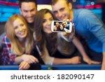 smiling friends taking selfie... | Shutterstock . vector #182090147