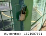 Padlock On The Iron Door Of...