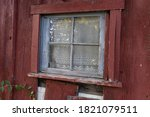 Window In An Old Red Barn On A...