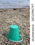 A Kids Lost Green Sand Bucket
