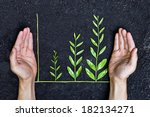 hands holding tree arranged as... | Shutterstock . vector #182134271