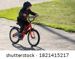 Boy Cycling In The Open Air....