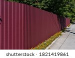 Red Metal Corrugated Fence...