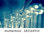 pipette adding fluid to one of... | Shutterstock . vector #182164514