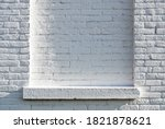 Empty Ledge On A White Brick...