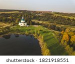 the pond and the church of... | Shutterstock . vector #1821918551