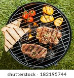 two lamb chops cooking on a bbq ... | Shutterstock . vector #182195744