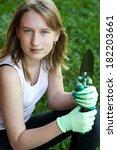 gardener. girl working in garden | Shutterstock . vector #182203661
