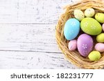 Easter Eggs In Nest On Color...