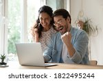 Small photo of Overjoyed millennial man and woman triumph win online lottery on laptop. Happy excited young Caucasian couple feel euphoric with good email, get amazing sale offer or discount deal on computer.