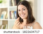 Happy Woman Eating Vitamin Pill ...