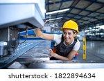 Female Factory Worker In...