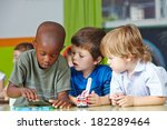 three children in kindergarten... | Shutterstock . vector #182289464