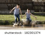 little happy boy jumping in... | Shutterstock . vector #182301374