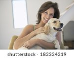 Lovely Woman And Dog At Home