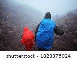 Hikers In Raincoats Walk...