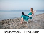 woman relaxing at the beach in... | Shutterstock . vector #182338385