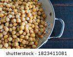Small photo of Soaked Chickpeas Drained in a Colander: Dried garbanzo beans that have been soaked in water and drained in a colander