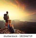 young tourists enjoying sunrise ...   Shutterstock . vector #182346719