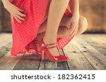woman in red skirt  | Shutterstock . vector #182362415