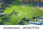 Small photo of Cultivated land and land plot or land lot. Consist of aerial view of green field, agricultural plant and ridge. That is tract of land for cultivate, owned, sale, development, rent, buy or investment.