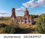 Small photo of ancient abandoned and ruined church, dilapidated red brick temple, abandoned red brick temple illuminated by the setting sun, an abandoned church at sunset, abandoned church of the Annunciation, fligh