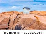 Small Wooden Hut On A Granite...