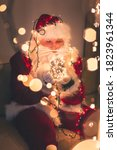 Portrait Of Santa Claus Holding ...