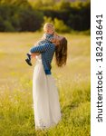 happy mother with baby outdoors ... | Shutterstock . vector #182418641